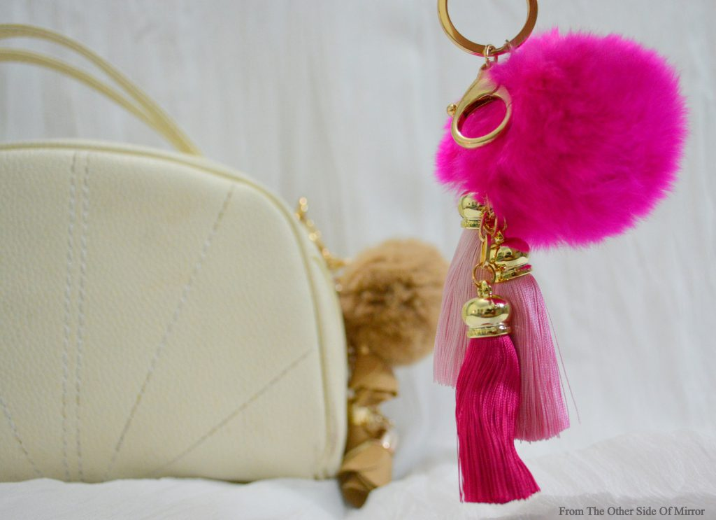 Add a little bounce to you bags, accessorize with these fuzzy Pompoms!